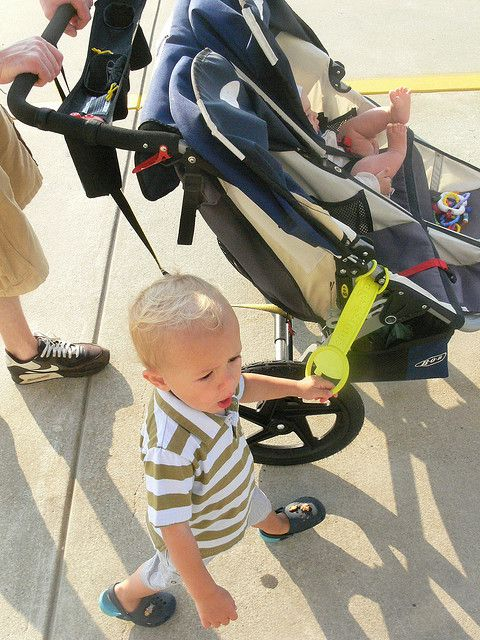 Attach something to the stroller for your older child to hold onto, so that he feels included and so that you know exactly where he is, without rolling over his little feet. Make a Big Brother/Sister Handle out of something you've already got in the house. Some ideas are listed...