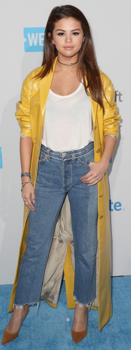 Who made Selena Gomez's white top, yellow trench coat, brown pumps, blue jeans, and jewelry?