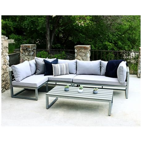 Extend your living space outdoors with this handsome and comfortable, all-weather, four-piece patio sectional conversation set with plush gray cushions.