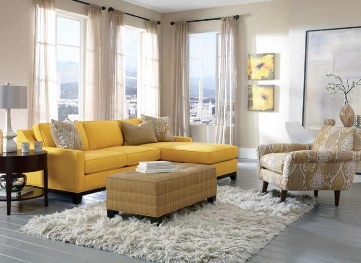 Make a statement with a bold canary yellow sectional combined with neutral accessories like accent chairs and ottomans.