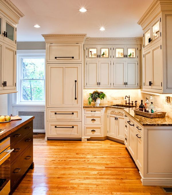 Lovely lighting accentuates the beauty of this elegant kitchen in white