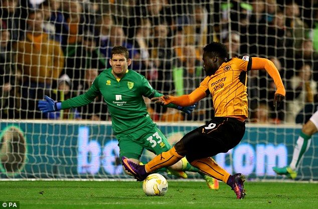 Wolves' Nathan Dicko sees his shot on goal saved by Norwich keeper Michael McGovern