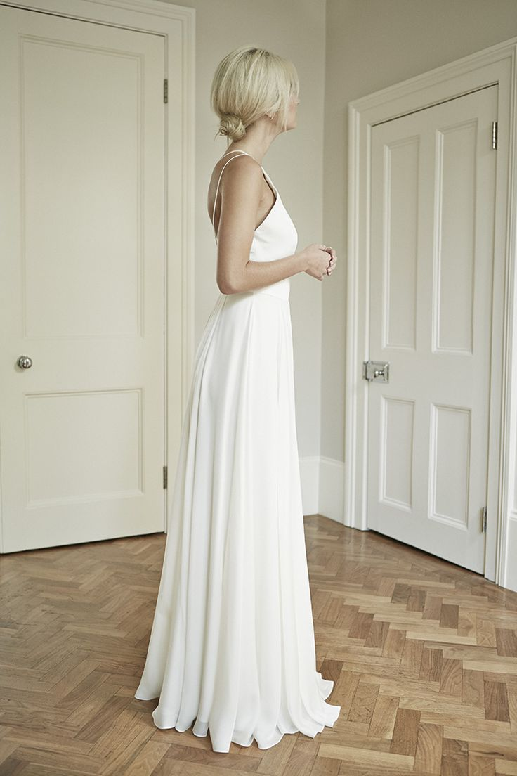 So simple and elegant. Charlotte Simpson backless spaghetti strap floaty wedding dress