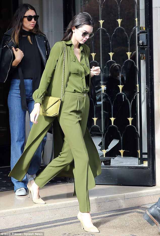 Looking lithe: She made wide strides from her hotel in a pair of camel court shoes...