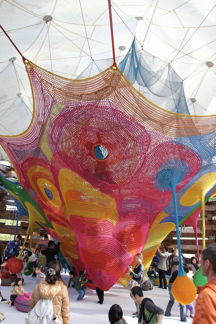 "Japanese artist Toshiko Horiuchi-MacAdam is considered one of Japan's leading fiber artists, using knitting and crochet as the foundation for much of her work. Her website explains that she specializes in ""creating large, interactive textile environments that function both as imaginative and vibrant explorations of color and form, at the same time as providing thrilling play environments."""