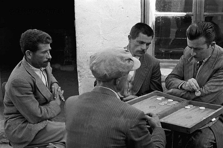 "Playing the traditional Greek game called ""tavli"" in Crete, Greece   source: agonaskritis.gr"