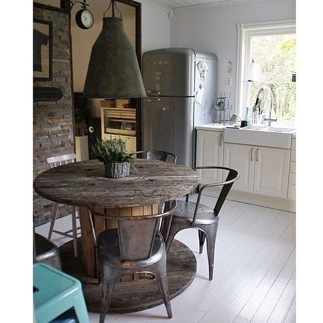 Old Wooden Cable Spool Re Purposed Into A Rustic Dining Table.old Metal  Light Fixture. Like The Table Idea If You Could Work Around The Off Balance  Chairs ...