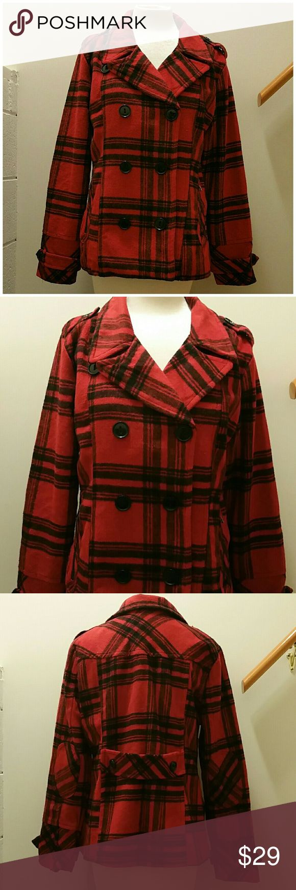 "Plaid wool blend pea coat. Size XL Excellent condition. Barely worn. Lost weight, too big for me now. Double breasted pea coat style. Red/black plaid. Wool blend. Lined, large zippered pockets. Measures approx. 27"" in length, sleeves measure approx. 25"". Juniors XL, bust measures approx. 34/36"". Fits a ladies size 10. No flaws. Dollhouse Jackets & Coats Pea Coats"