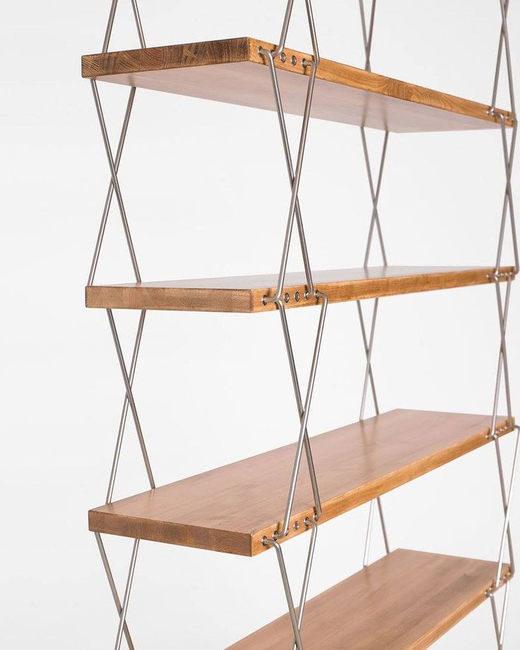 "Bookcase – shelves with a variable height A product of the ""Pictures of Polish design"" series. The bookcase was designed in 1959 by known Polish designers, the founder of the Department of Industrial Design at the Academy of Fine Arts in Poznan and Rajmund Teofil Hałas, the lecturer in the School of Architecture and Planning at the University in Poznan."
