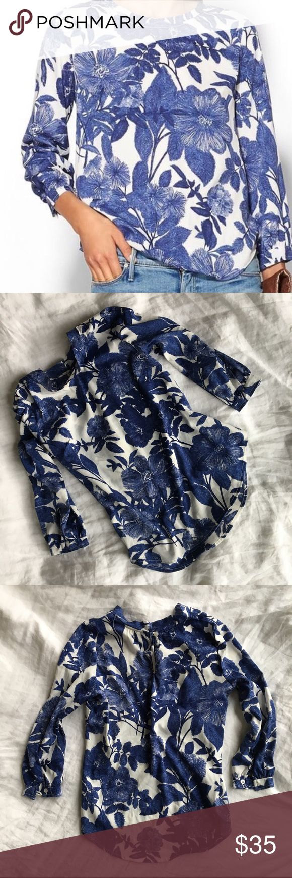 [ANTHROPOLOGIE] blue white floral Blouse PORRIDGE Porridge brand blouse from ANTHRO - 3/4 sleeve- button back closure- shirt tail hem- popover Blouse- fun funky vintage inspired print, great with jeans or paired up with a pencil skirt for work- perfect condition- sz XS Anthropologie Tops Blouses