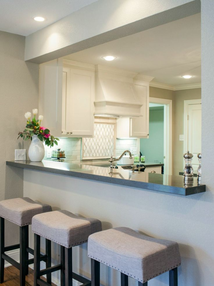 Like the idea of counter-height countertops on kitchen side and bar-height on foyer side with bar stool seating possible if it doesn't look too cluttered