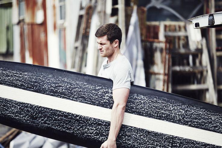 Scott wears Lamrock Henley Tee In Grey Marle #campbellandhall #mensclothing #surfboard