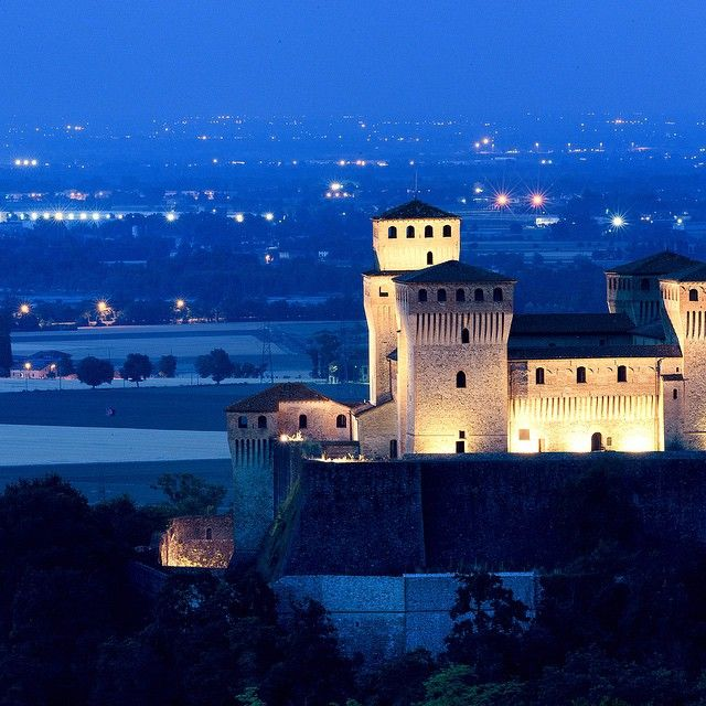 A guardian suspended between past and present..#Torrechiara's #Castle, shining in the night - Instagram by giulianobianchini