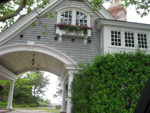 Arched window..molding.  Room has been kicked out and done with wood.  Arch above carport with wood keystone.