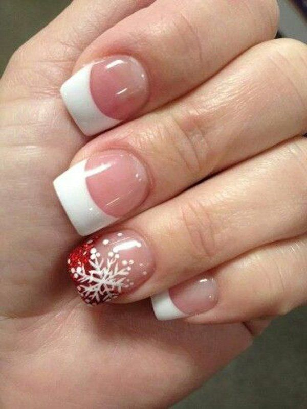 A classic French tip with a twist. Although the rest of the nails look like your average French tip; light pink base and white tip, the other nail tip is coated in blazing red nail polish. To accent it better glitters have been added and a beautiful white snowflake is then drawn over the red nail tip.