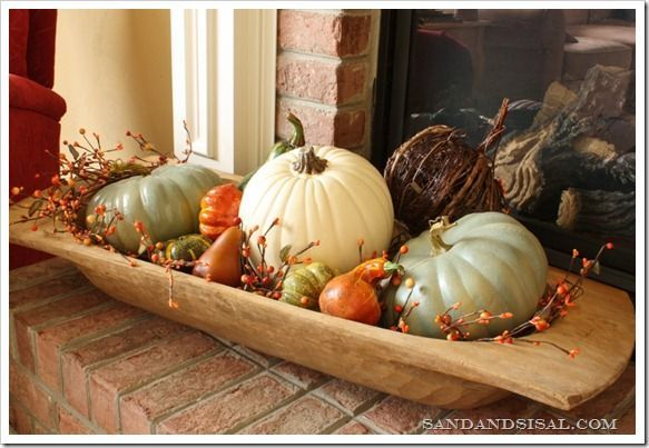 anderson + grant: Collection of 20 Fall Decorating Ideas. Pumpkins of various sizes in a wooden oval bowl.