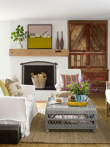 Easy and Breezy - The owner of this California home upgraded her living room's catalog buys, painting a wicker coffee table from Williams-Sonoma in Farrow  Ball's Pavilion Gray and slipcovering the Pottery Barn sofa in French bed linens.  She had the cabinet built using salvaged barn wood.