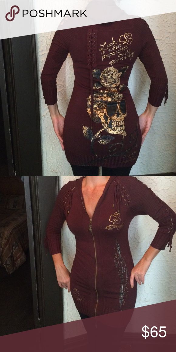 Ed Hardy knit brown zip up hoodie Ed Hardy by Christian Audigier size medium hoodie. Brown with see through lace up detail on arm sleeve & top back. Amber rhinestone detail surrounding Ed Hardy name in three places.  Also around the sunglasses of the skeleton head in the back. Preowned worn lightly Ed Hardy Sweaters