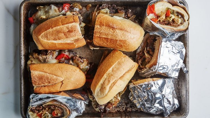Look for short ribs with the most marbling possible for these cheesesteaks; if you really want to splash out, use boneless rib eye.