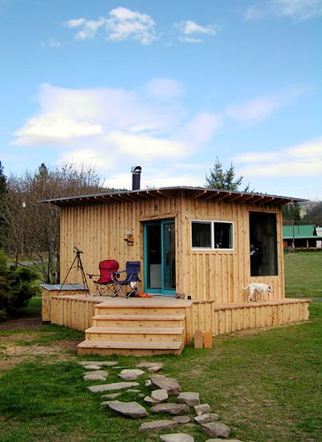 Why couldn't this be given a sloped shed roof and made of pallets?  With the roof continuing over the porch area for added dry space?
