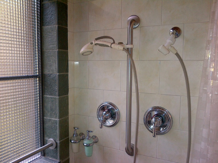 The roll in shower has two shower heads with separate controls.  One is fixed up high and the second is on a flexible hose.  The window has a grab bar down low and all the towel racks are actually reinforced grab bars at recommended heights.