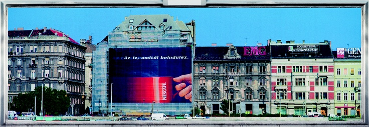 This advertisement, photographed from across the Danube, is so large and so bizarre in the context of the the living space it has been placed into that it seems as though a window has opened in space and we are glimpsing another massively enlarged, parallel universe.