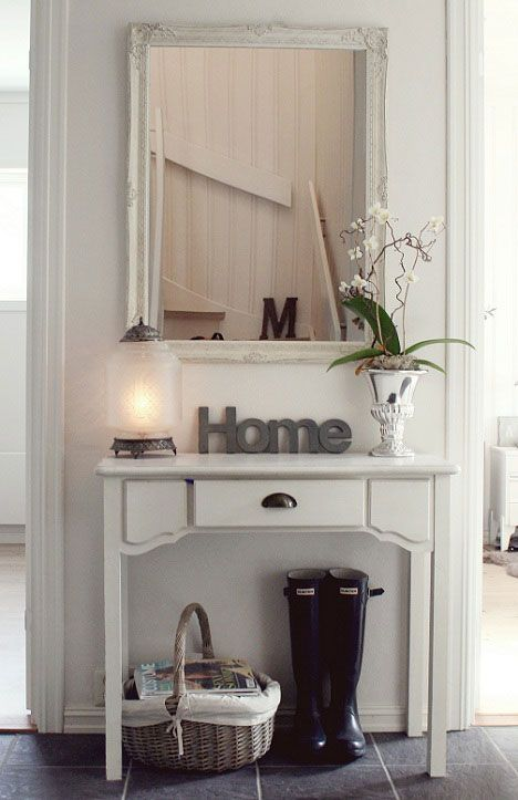 mirror and table in hallway
