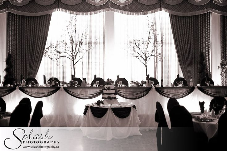 Good concept for a wedding head table, esp like the ruched, black draping.