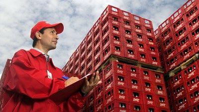 Coca-Cola HBC employee checking creates of Coca-Cola