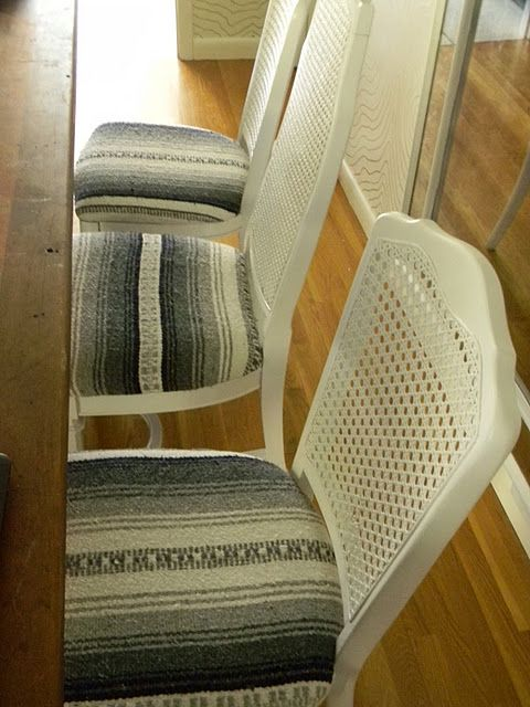 Chairs upholstered with a Mexican blanket.