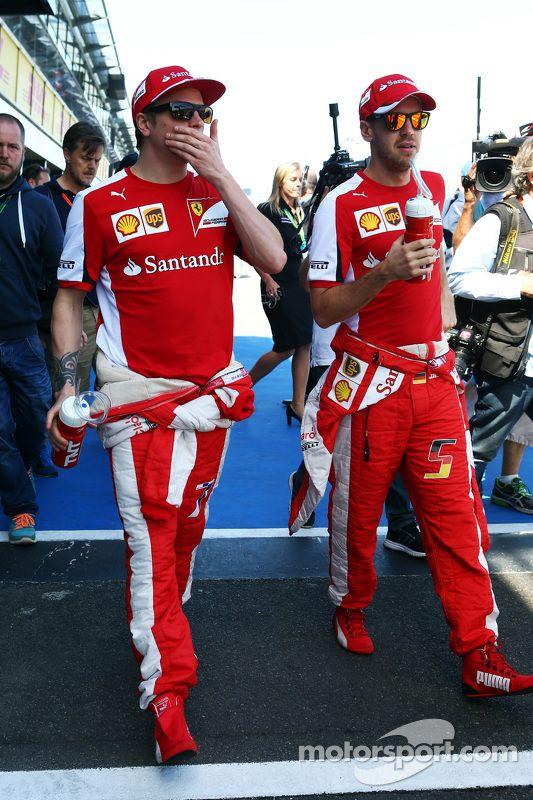 (L to R): Kimi Raikkonen, Scuderia Ferrari with Sebastian Vettel, Scuderia Ferrari