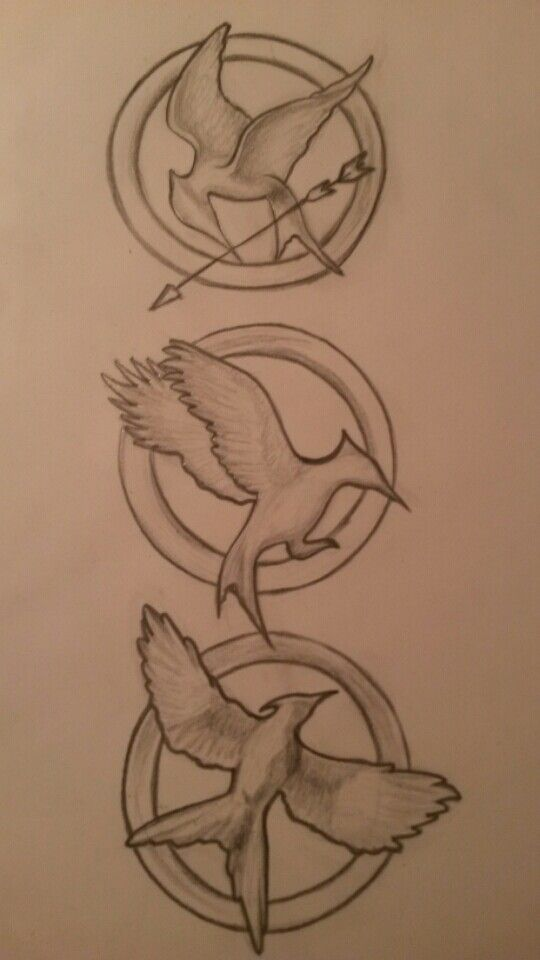 The hunger games logos i drew By Shona ♥