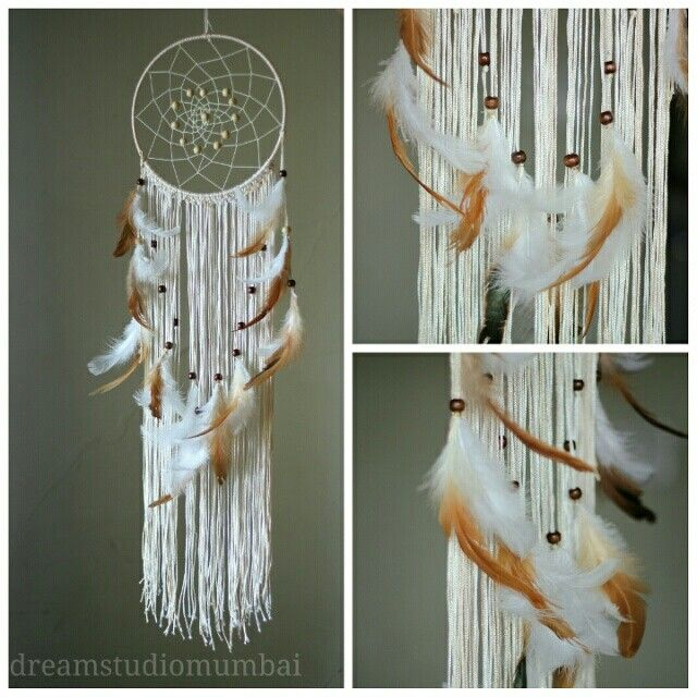 Cream n white dreamcatcher with flecks of brown...this one took a helluva lot of time..pretty good i say for a beginner like me..pleased with myself :)