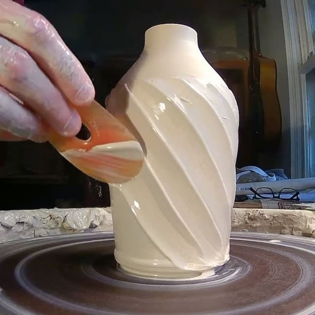 Bottle with spiral slip- I'm excited, this is my first video to feature music!  The song is Cleopatra by @thelumineers. I love this song!  Here's what I'm doing in the video- First I throw a bottle (in this case it will be an olive oil bottle) One of the important things in making a bottle is that the walls have to be very uniform, because in order to collar in the neck, if there are any spots that are too thin, it just might buckle. After throwing the bottle, I add a generous amount of...
