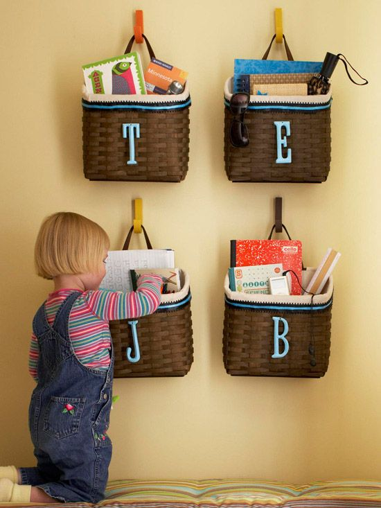 Cut clutter by assigning a drop basket for everyone in the family. More storage solutions using baskets: http://www.bhg.com/decorating/storage/organization-basics/storage-solutions-using-baskets/?socsrc=bhgpin080312labeledfamilystoragebaskets#page=10