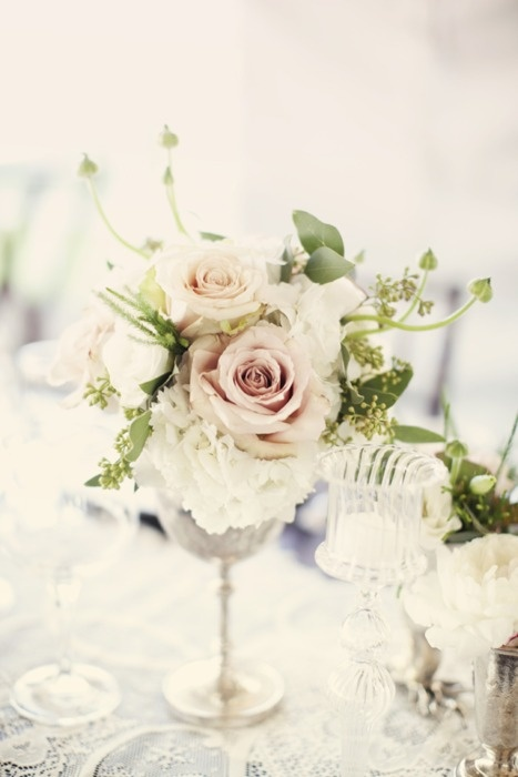 The cocktail tables will be small vintage silver goblet with white hydrangeas and blush pink spray roses surrounded by mercury glass votives.
