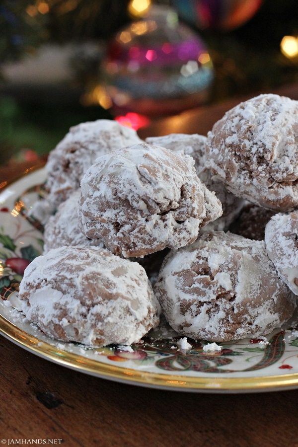 Hot Chocolate Snowballs _ These delicious cookies have a few surprises inside. First, they are made with hot chocolate mix, meaning you can use a plain mix or jazz things up a bit by using a flavored hot chocolate.  Second, they have a bit of cream cheese mixed into the dough, giving them a great flavor & texture! #Cookies