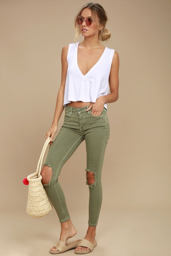 Go high-waisted or go home! The Free People High Rise Busted Olive Green Distressed Skinny Jeans are shaped by perfectly stretchy denim with a high-waisted fit, belt loops, and five pocket cut. Skinny pant legs with distressed knees. Branded top button and hidden zip fly.