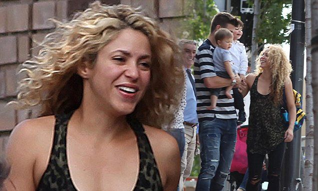 Shakira enjoys a family day out with her hunky husband and their sons