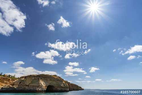 Algar Seco coast line with caves in Algarve, Portugal with stunning sky and turquoise ocean.  View from boat