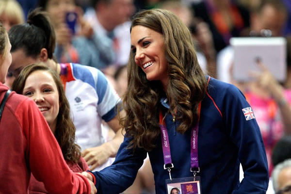 Kate speaks to a spectator during the artistic gymnastics apparatus finals on Sunday, Aug. 5.