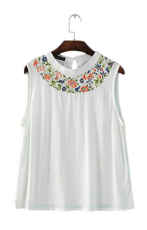 Elegant white top with floral embroidery