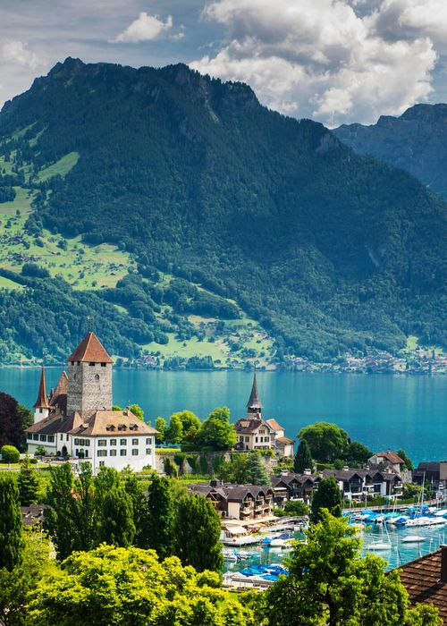 """Spiez, Switzerland. And this church pictured is one of those """"i would so get married here' kind of churches."""