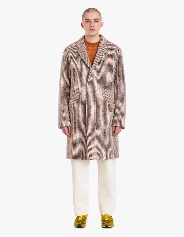 "Coat from <a href=""http://tres-bien.com/apc/"" class=""uniquelink"">A.P.C.</a> Made from a virgin wool blend. Notched lapels. Three button closure on the front. Two slanted front pockets. Fully lined. Straight cuffs and hem."