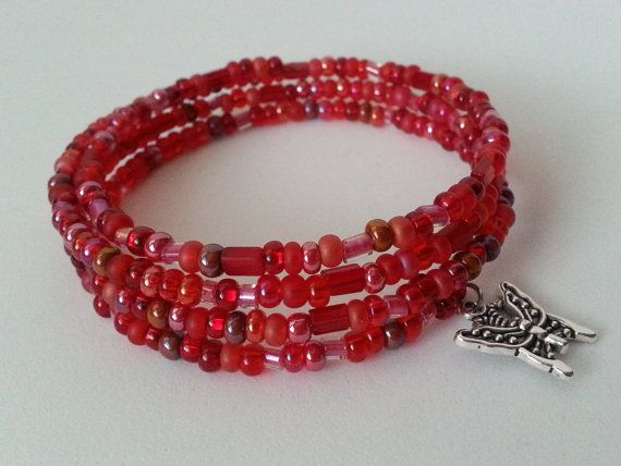 Memory wire bracelet in red with charm.