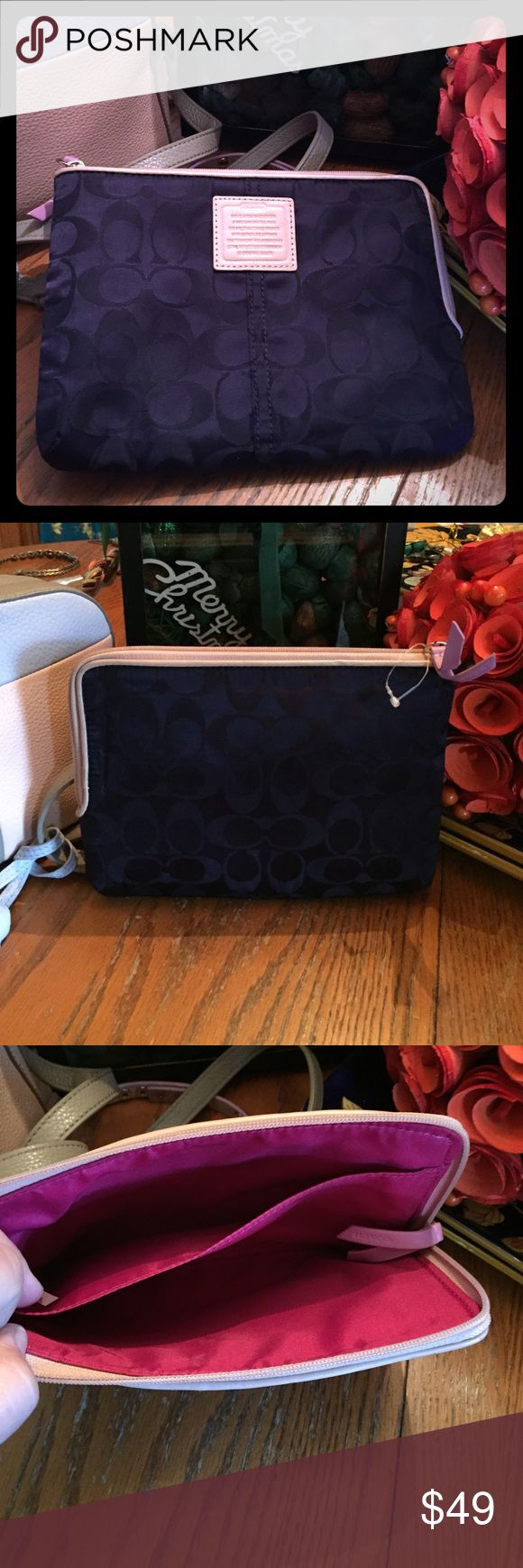"Coach I pad or wallet navy blue authentic COACH navy blue 8.5"" x 6.5"" is original iPad case or wallet brand-new still has the price tag thingy attached around the zipper tag and the coach accessory authenticity is on the outside of the bag small sleeve on the inside of the bag the inside is lined with the light satin material from a smoke-free pet free home happy poshing cheers 🎉🍾 Coach Bags Mini Bags"