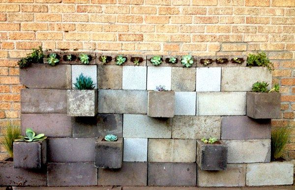 anter walls are ALL OVER THE INTERNET. In fact, they're some of the most pinned images of all time. I know–they're definitely not new news at this point, but I just couldn't write this post without including at least one of them. I love this Cinder Block Planter and Succulent Brick Wall, precisely because of the many tones of grey represented. The reason: the wall was built using cinder blocks that were left in Society Bride blogger Robin's new yard. Using leftovers with a history really…