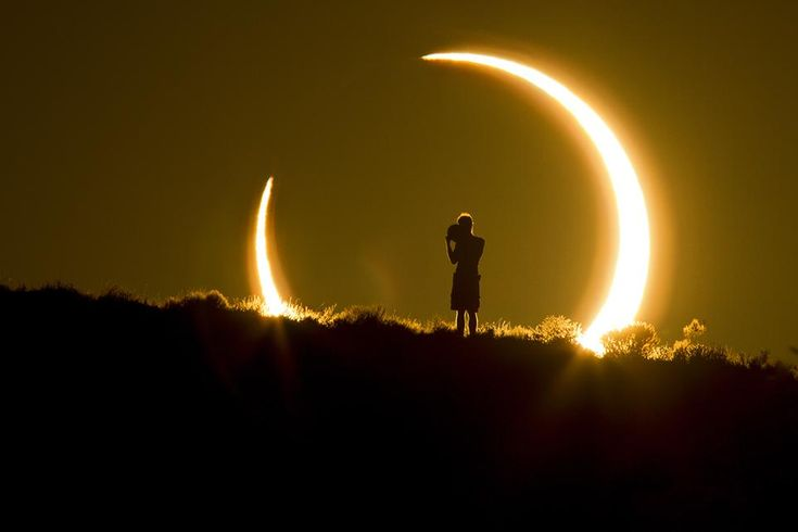 An Onlooker Witnesses the Annular Solar Eclipse as the Sun Sets on May 20, 2012