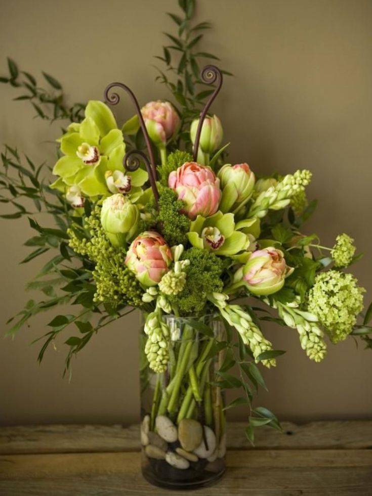 Floral arrangement with cymbidium orchids and monkey tail
