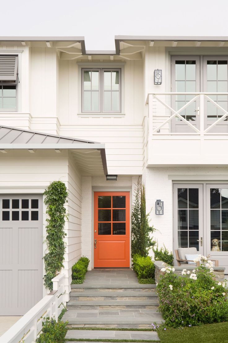 The 6,500-square-foot coastal-style home was brought to life by contractor Matt Morris Development and architect Douglas Leach. When it came to life outside, the homeowners looked to Jones Landscapes to provide the lush plantings and manicured greenery that spans the property. Lucas chose Farrow & Ball's Charlotte's Locks to give the front door a complementary pop and Pratt & Lambert's Driftwood for subtle contrast on the garage and casings.